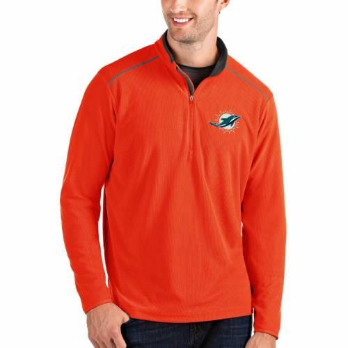 ANTIGUA マイアミ ドルフィンズ メンズファッション コート ジャケット メンズ 【 Miami Dolphins Glacier Quarter-zip Pullover Jacket - Black/gray 】 Orange