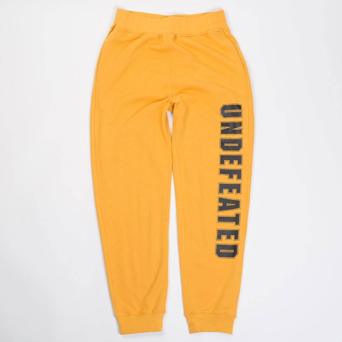 【海外限定】ズボン メンズファッション 【 UNDEFEATED MEN COMPACT SWEATPANTS GOLD 】