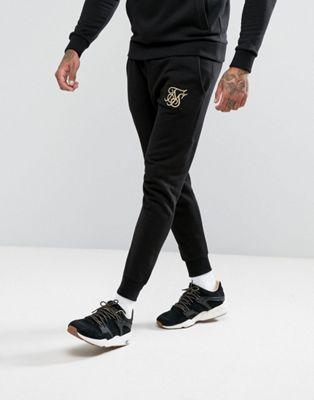 ロゴ ジョガーズ ゴールド 金 ブラック 黒 イン siksilk joggers in black with gold logo メンズファッション ズボン パンツ