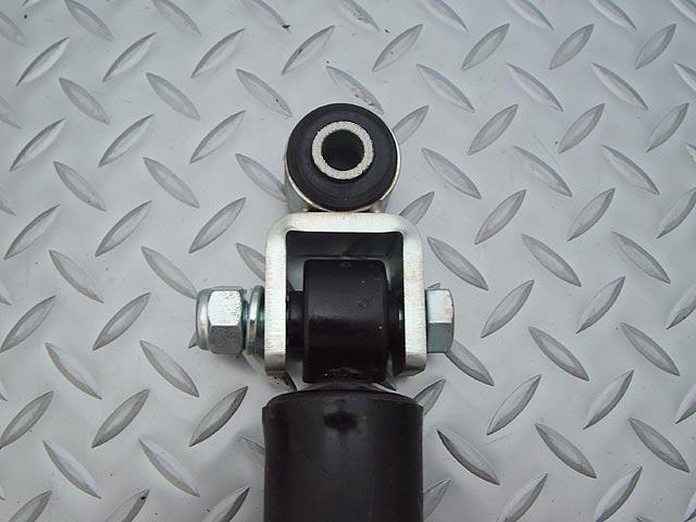Shock extension bracket for rubber bushing type JB23