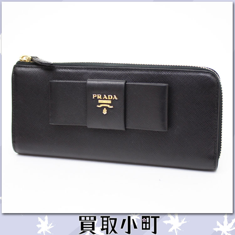 cdec4dd3a718d4 The long wallet where big ribbon is impressive in basic サフィアーノカーフ. It is  the model who storing is substantial, and is functional.