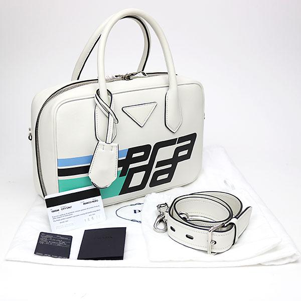 0f2bd6d15974 KAITORIKOMACHI: Prada leather top steering wheel bag white + black ...