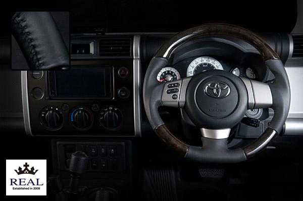 【 FJクルーザー GSJ15W (北米&国内仕様装着可)用 】 レアル ステアリング オリジナルシリーズ (プレミアムブラックウッド / ブラックステッチ) 品番: FJ-BKW-BK (REAL Steering 純正交換タイプ)
