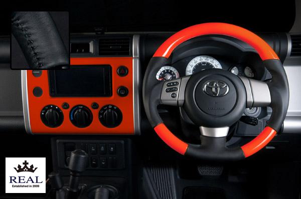 【 FJクルーザー GSJ15W (北米&国内仕様装着可)用 】 レアル ステアリング オリジナルシリーズ (オレンジ / ブラックステッチ) 品番: FJ-ORW-BK (REAL Steering 純正交換タイプ)