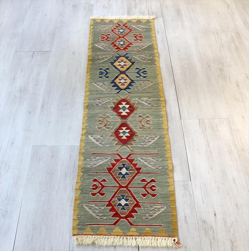 トルコ手織りキリム・ウシャク ランナー144×40cmイーブルアイのモチーフ