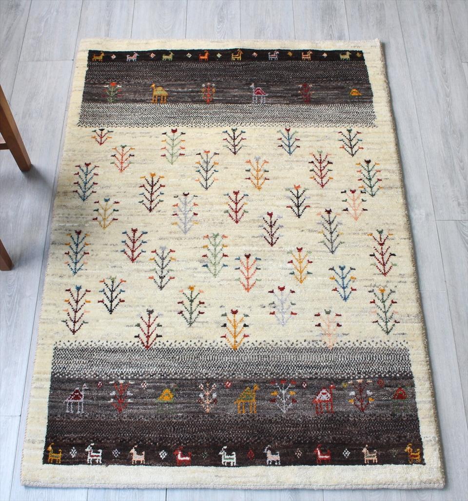 ギャッベ/ギャベ・カシュカイ族の手織りラグ・アマレ・玄関マット/アクセントラグサイズ147x100cm ナチュラルアイボリー&ダークブラウン・生命の樹と動物モチーフ