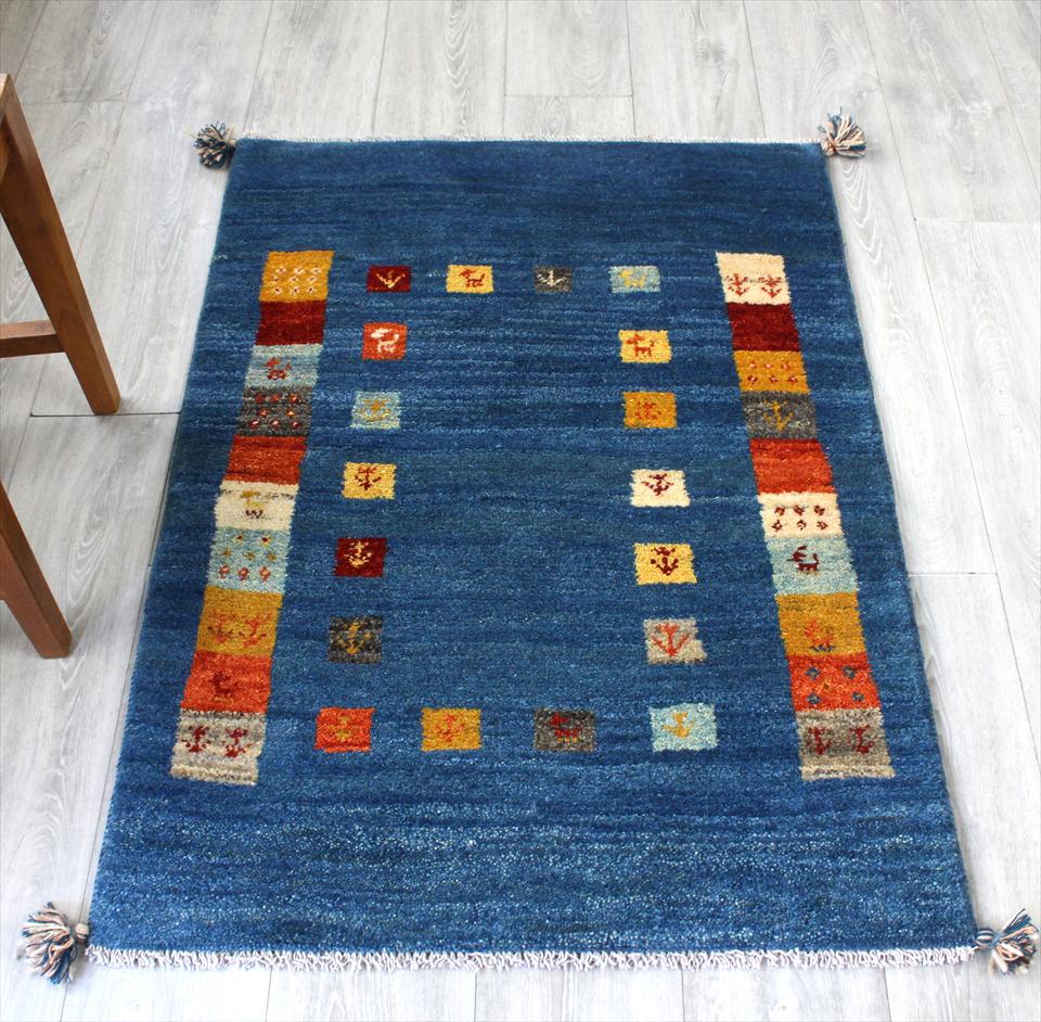 ギャッベ/ギャベ・カシュカイ族の手織りラグ・アクセントラグサイズ117x82cm ブルー・カラフルスクエアタイル・動物と植物のモチーフ