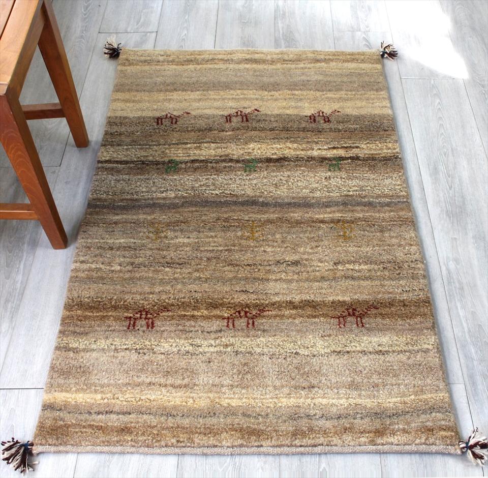 ギャッベ/ギャベ・カシュカイ族の手織りラグ・アクセントラグサイズ122x78cm ナチュラルブラウン&グレー&アイボリーグラデーション・動物と植物のモチーフ