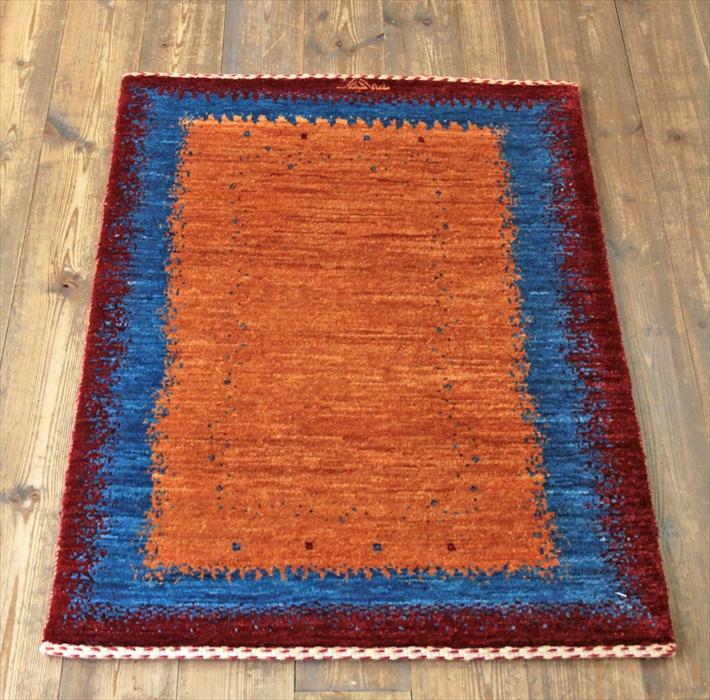 カシュカイ族の手織りギャッベ・玄関マットサイズ・ラグ イラン(ペルシャ)ウール100%/86×61cmレッド・ブルー/オレンジ グラデーション 小さなドット
