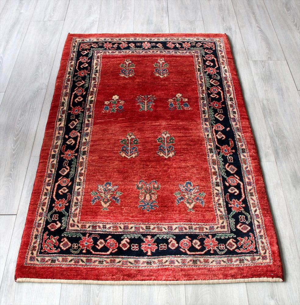 ルリバフ・ギャッベ/カシュカイ族の手織りラグ・細かな織りの伝統柄132x82cm アクセントラグ・レッド/花束のモチーフ