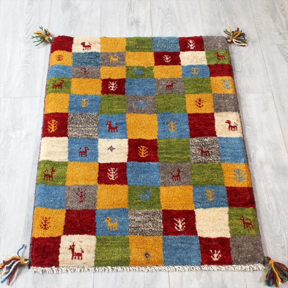 ギャッベ(ギャベ)カシュカイ族の手織りラグ・Gabbeh・玄関サイズ88x60cm カラフルタイル・動物と植物モチーフ