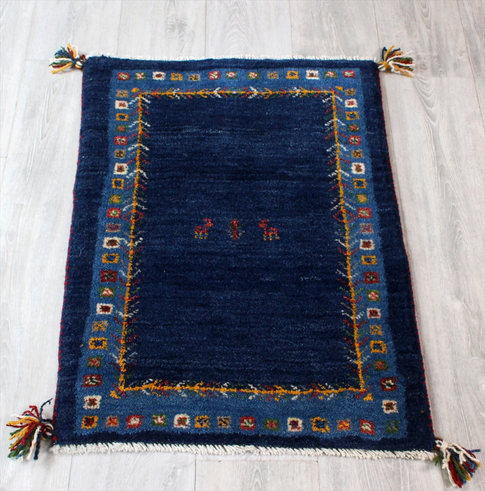 ギャッベ(ギャベ)カシュカイ族の手織りラグ・Gabbeh・玄関サイズ83x60cm ネイビー・ブルーボーダー・カラフルスクエア 動物と植物モチーフ