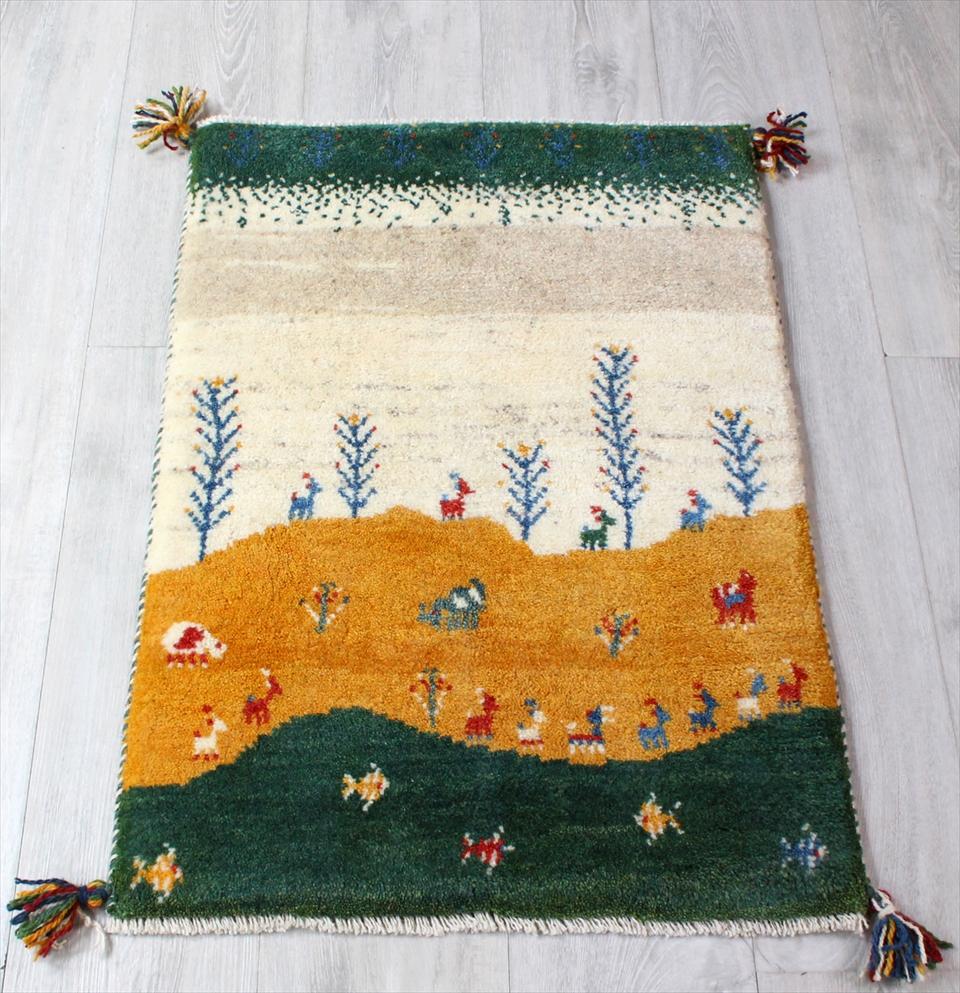 ギャッベ(ギャベ)カシュカイ族の手織りラグ・Gabbeh・玄関サイズ83x57cm カラフル 自然風景 動物と植物、お魚モチーフ