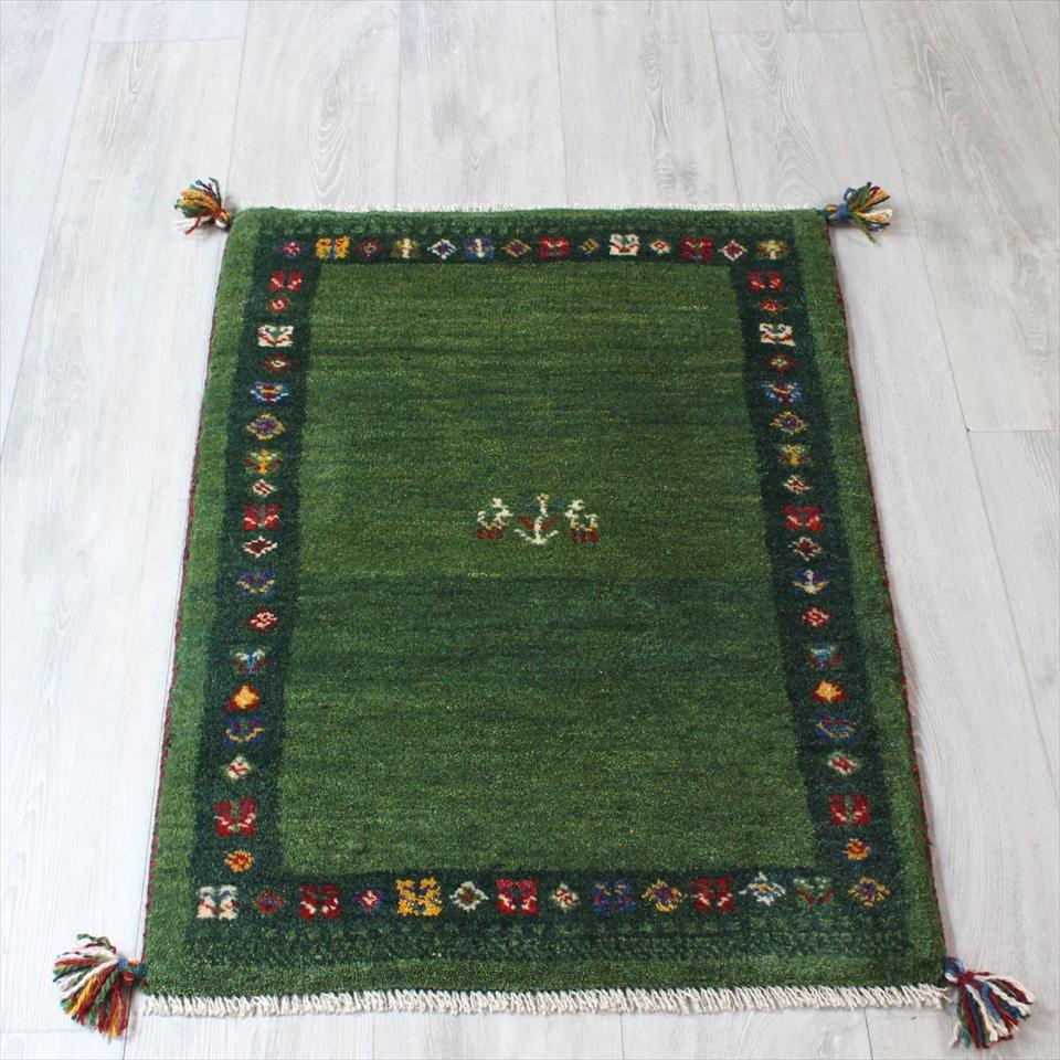 ギャッベ(ギャベ)カシュカイ族の手織りラグ・Gabbeh・玄関サイズ87x63cm グリーン・グリーンボーダー・カラフルなモチーフ 動物と植物