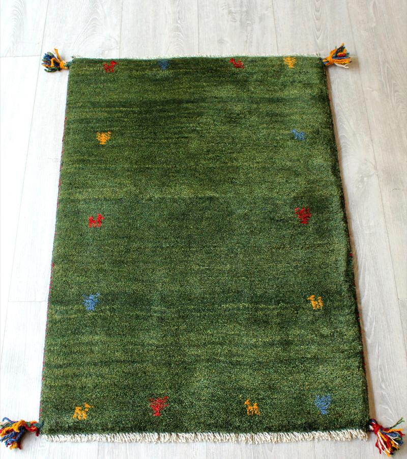 ラグ・ギャッベ(ギャベ)カシュカイ族の手織りラグ・玄関マットサイズ88x58cm グリーン・動物と植物のモチーフ