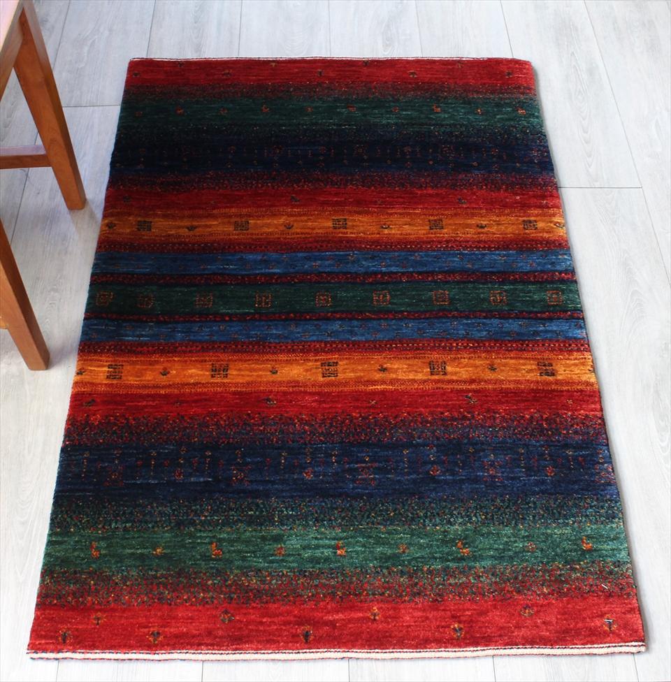 ギャッベ ギャベ ウール 玄関 カシュカイ族の手織りラグ最上級の織り・ロリアタシュ・アクセントラグサイズ119x80cm カラフルストライプ・動物と植物モチーフ