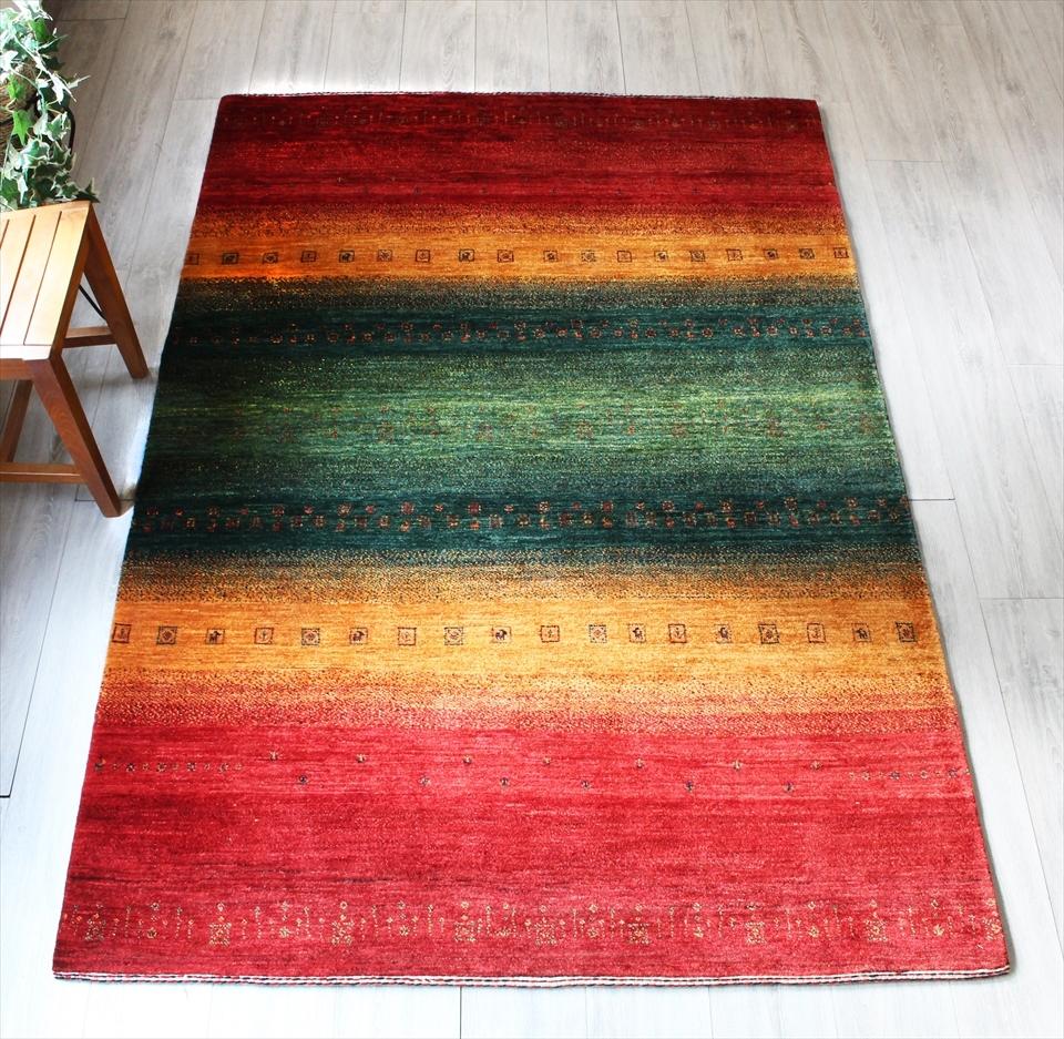 ギャッベ ギャベ カシュカイ族の手織りラグ最上級の織り・ロリアタシュ・センターラグサイズ210x147cm カラフルストライプ・ラスターカラー・スクエア動物と植物モチーフ