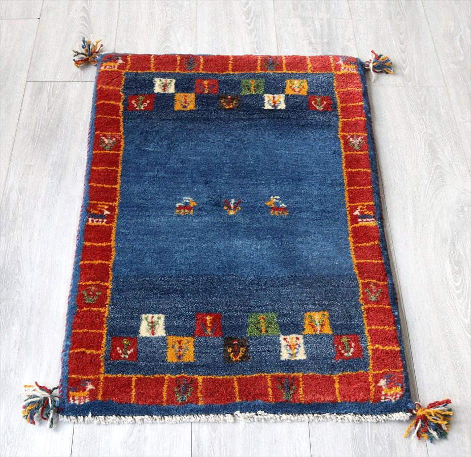 ラグ・ギャッベ(ギャベ)カシュカイ族の手織りラグ・玄関マットサイズ90x58cm ブルー&レッド・動物と生命の樹