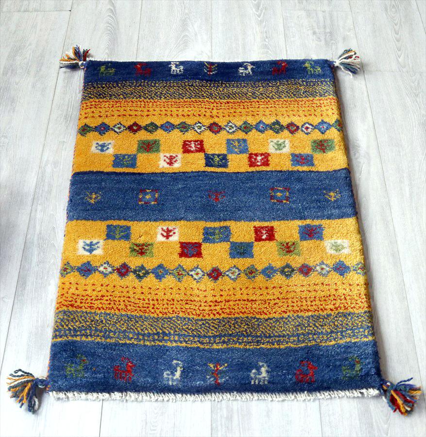 ラグ・ギャッベ(ギャベ)カシュカイ族の手織りラグ・玄関マットサイズ88x60cm ブルー&イエロー・動物と生命の樹