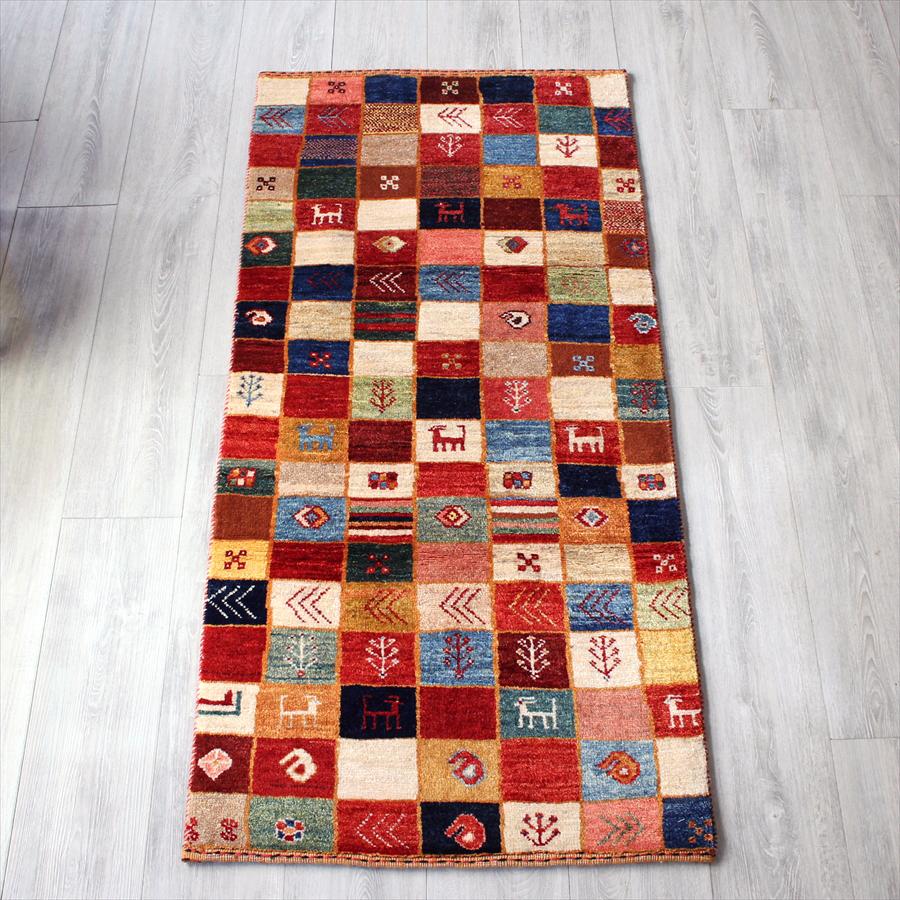 ギャッベ シューウリ・イラン直輸入カシュカイ族の手織りラグ/アクセントラグサイズ145x70cm カラフルなタイル・動物と植物のモチーフ