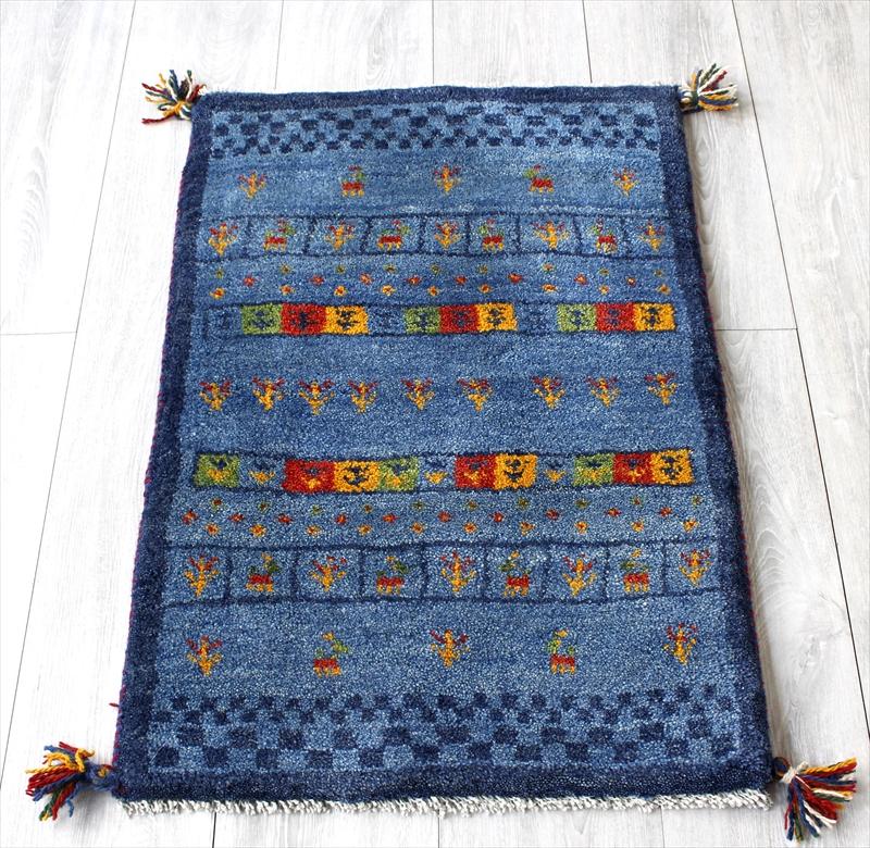 ラグ・ギャッベ(ギャベ)カシュカイ族の手織りラグ・玄関マットサイズ84x56cm ブルー・カラフル・動物と植物のモチーフ