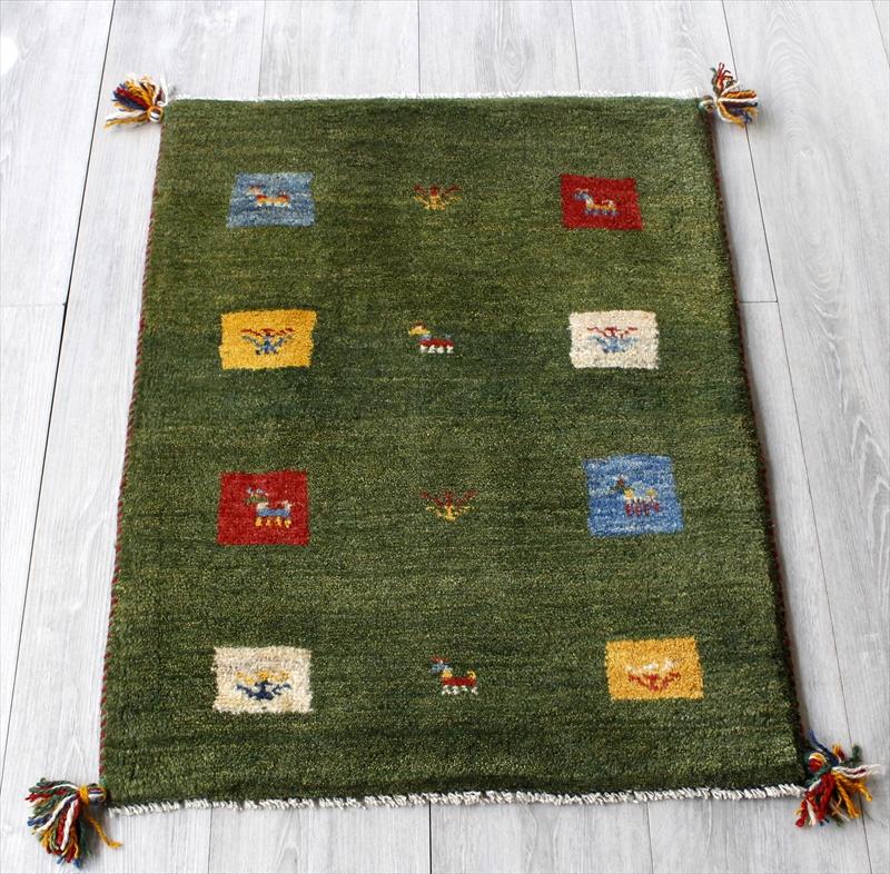 ラグ・ギャッベ(ギャベ)カシュカイ族の手織りラグ・玄関マットサイズ82x62cm グリーン・スクエア・動物と植物のモチーフ