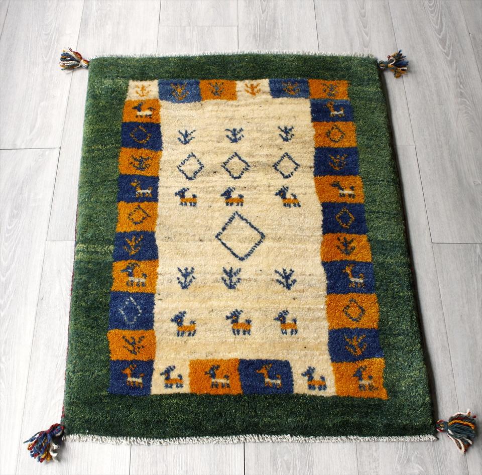 ギャッベ(ギャベ)カシュカイ族の手織りラグ・Gabbeh・玄関サイズ86x64cm ナチュラルアイボリー/カラフルタイル/グリーン・動物と植物のモチーフ