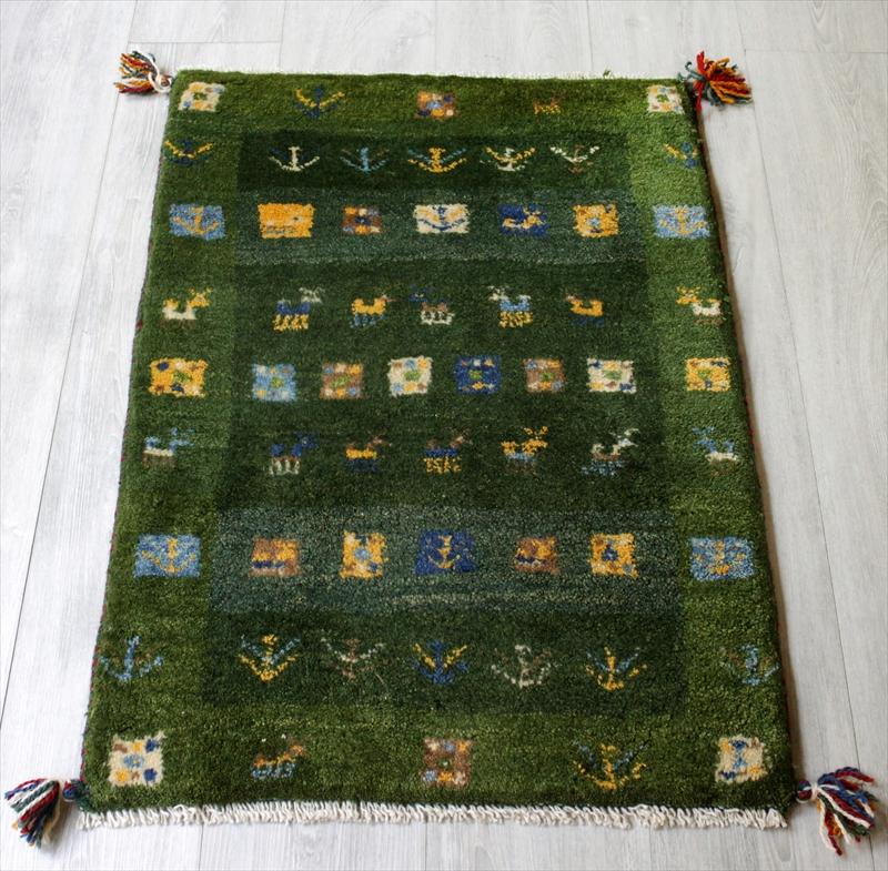 ラグ・ギャッベ(ギャベ)カシュカイ族の手織りラグ・玄関マットサイズ85x63cm グリーン・カラフルスクエア・動物と植物モチーフ