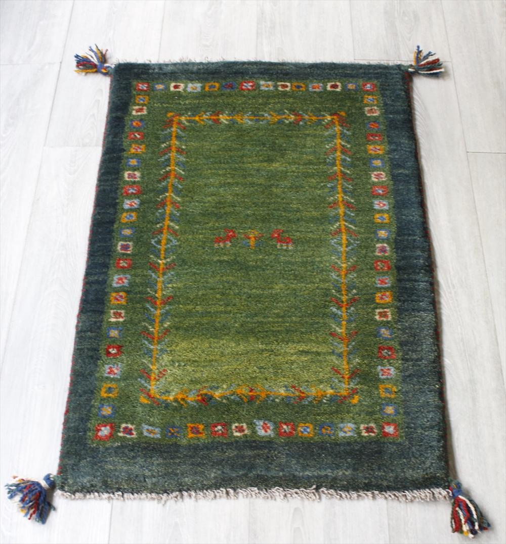 ラグ・ギャッベ(ギャベ)カシュカイ族の手織りラグ・玄関マットサイズ86x55cm グリーン・カラフルスクエア・動物と植物モチーフ