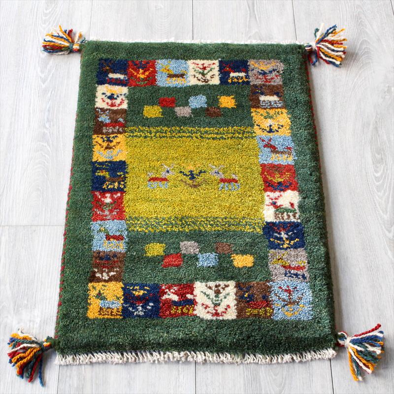 ラグ・ギャッベ(ギャベ)カシュカイ族の手織りラグ・ミニサイズ58x40cm グリーン・カラフルタイルボーダー・動物と植物のモチーフ
