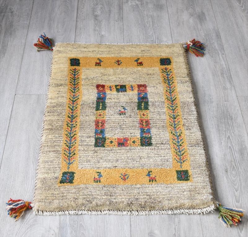 ギャッベ(ギャベ)カシュカイ族の手織りラグ・Gabbeh・玄関サイズ78x50cm ブラウン/イエロー 幾何学模様 動物モチーフ