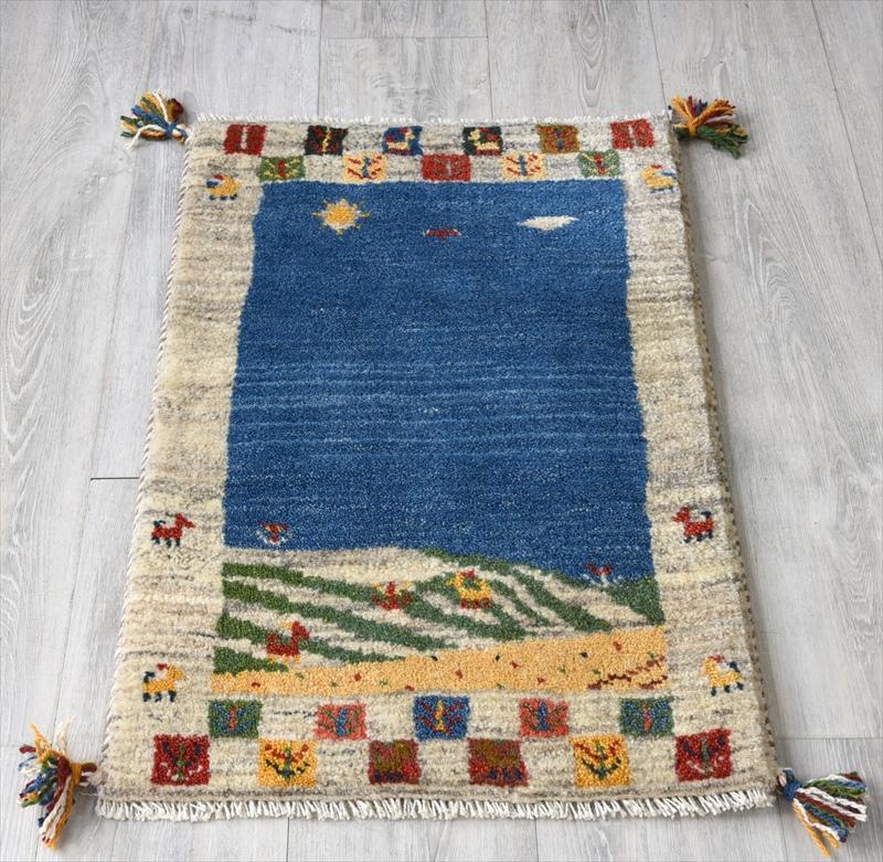ギャッベ(ギャベ)カシュカイ族の手織りラグ・Gabbeh・玄関サイズ80x50cm ブルー/アイボリー 幾何学模様 動物モチーフ