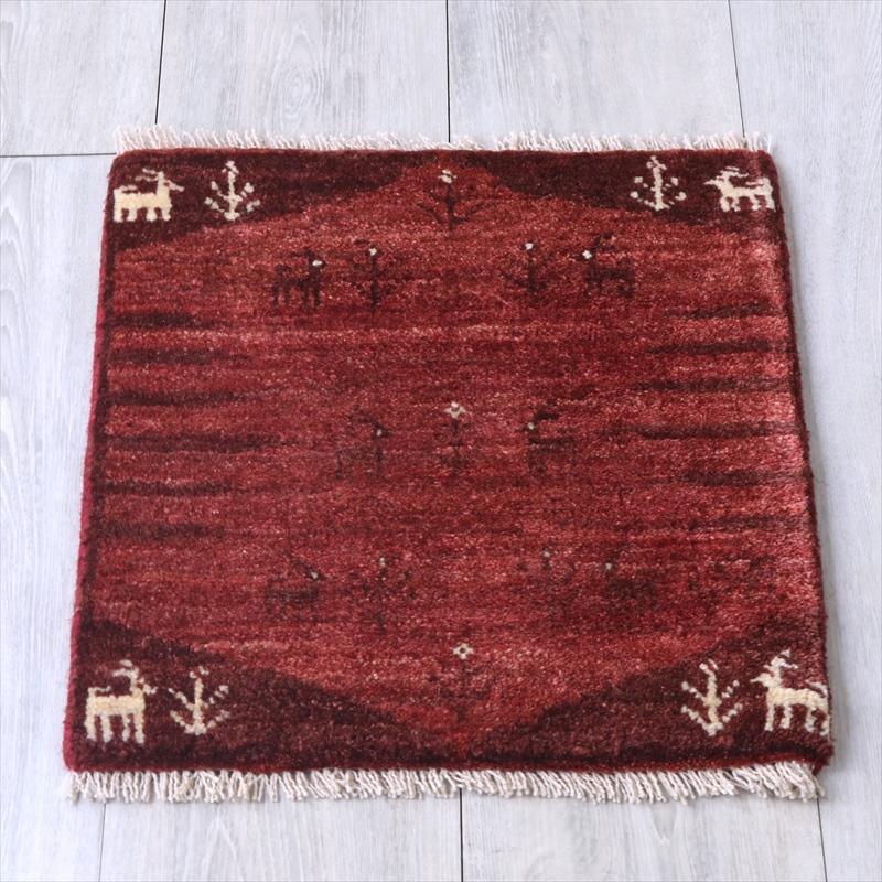 アマレ Amaleh /ギャッベ・カシュカイ族の手織りラグ 座布団サイズ44x41cm 赤い六角メダリオン