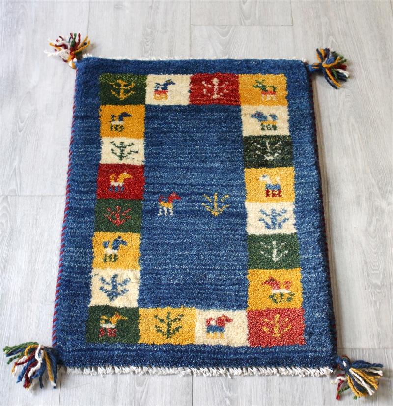 ミニ玄関マット・ギャッベ(ギャベ)カシュカイ族の手織りラグ・ミニサイズ57x39cm ブルー・カラフルタイル・動物と植物モチーフ