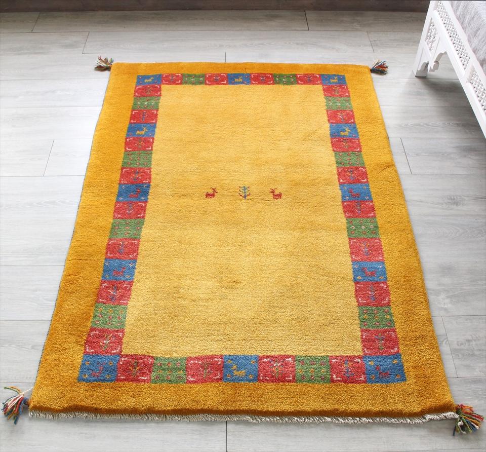 ギャッベ/ギャベ・カシュカイ族の手織りラグ・アクセントラグサイズ147x102cm イエロー/オレンジ・カラフルタイル・動物と植物モチーフ