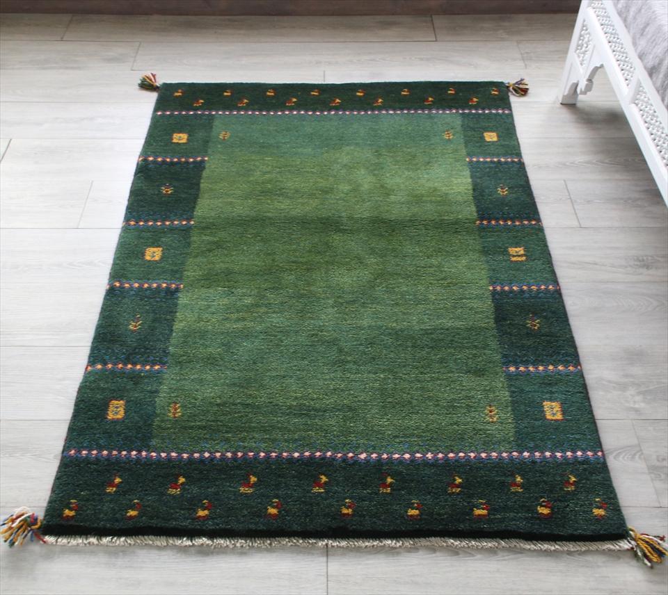 ギャッベ/ギャベ・カシュカイ族の手織りラグ・アクセントラグサイズ146x100cm グリーン/グリーン・スクエア 動物と植物モチーフ