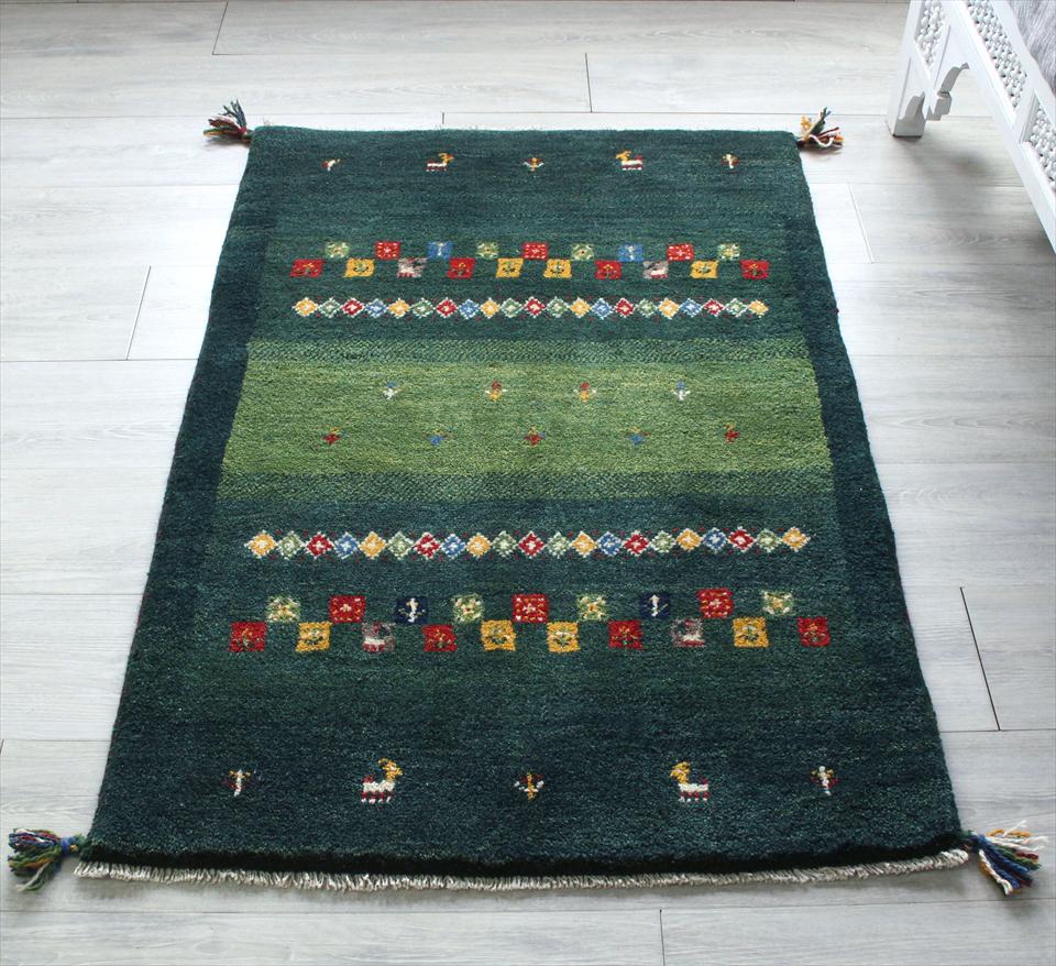 ギャッベ/ギャベ・カシュカイ族の手織りラグ・アクセントラグサイズ120x82cm グリーン・カラフルな幾何学モチーフ 動物と植物モチーフ
