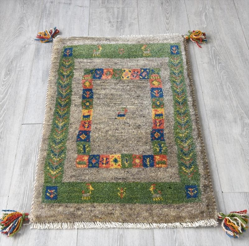 ギャッベ(ギャベ)カシュカイ族の手織りラグ・Gabbeh・玄関サイズ77x47cm ブラウン/グリーン 幾何学模様 動物モチーフ