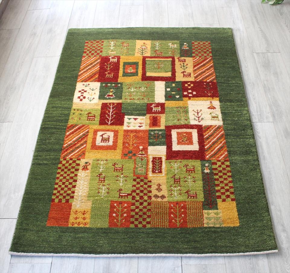 ギャッベ/ギャベ・カシュカイ族の手織りラグ・センターラグサイズ170x116cm リーフグリーン カラフルモザイク 動物・植物のモチーフ