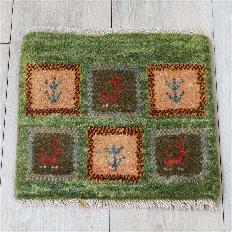 アマレ Amaleh /ギャッベ・カシュカイ族の手織りラグ 座布団サイズ33x34cm 動物と草花のあるタイル