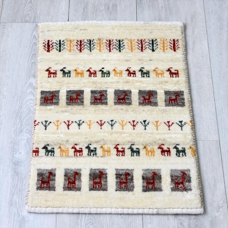 ギャッベ/ギャベ・カシュカイ族の手織りラグ・カシュクーリ・ミニサイズ55x37cm アイボリー カラフルな動物・植物のモチーフ