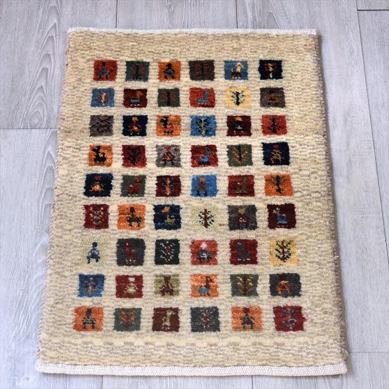 ギャッベ/ギャベ・カシュカイ族の手織りラグ・カシュクーリ・ミニサイズ59x37cm アイボリー カラフルなタイル 子供、動物と植物のモチーフ