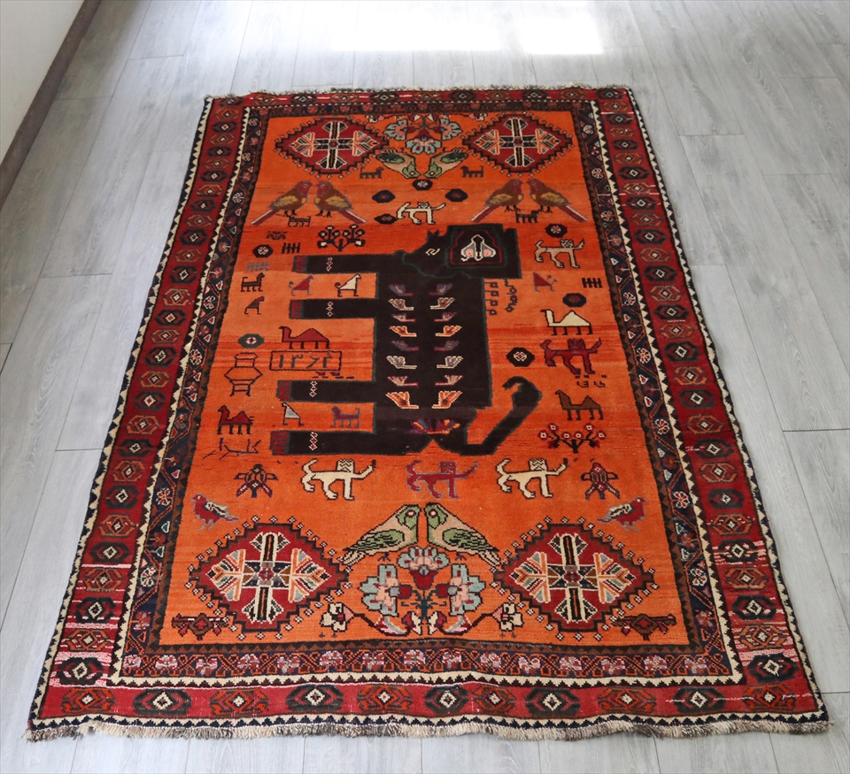 オールドギャッベ・カシュカイ族の伝統柄 ライオンラグ220x128cm オレンジ/黒いライオン