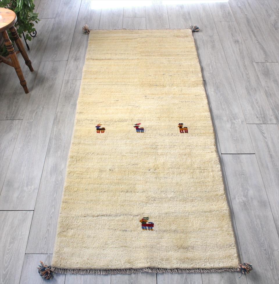 ギャッベ(ギャベ)カシュカイ族の手織り・イラン直輸入 ランナーサイズ190x77cm ナチュラルアイボリー・動物モチーフ