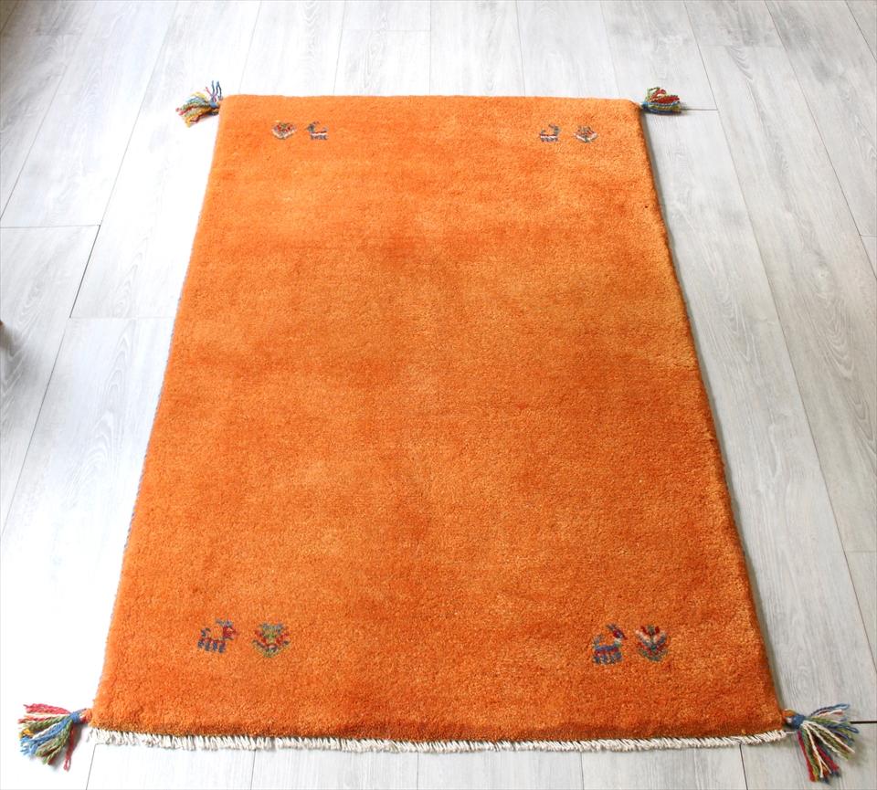ラグ・ギャッベ(ギャベ)カシュカイ族の手織りラグ・アクセントラグサイズ125x79cm オレンジ・動物と植物のモチーフ
