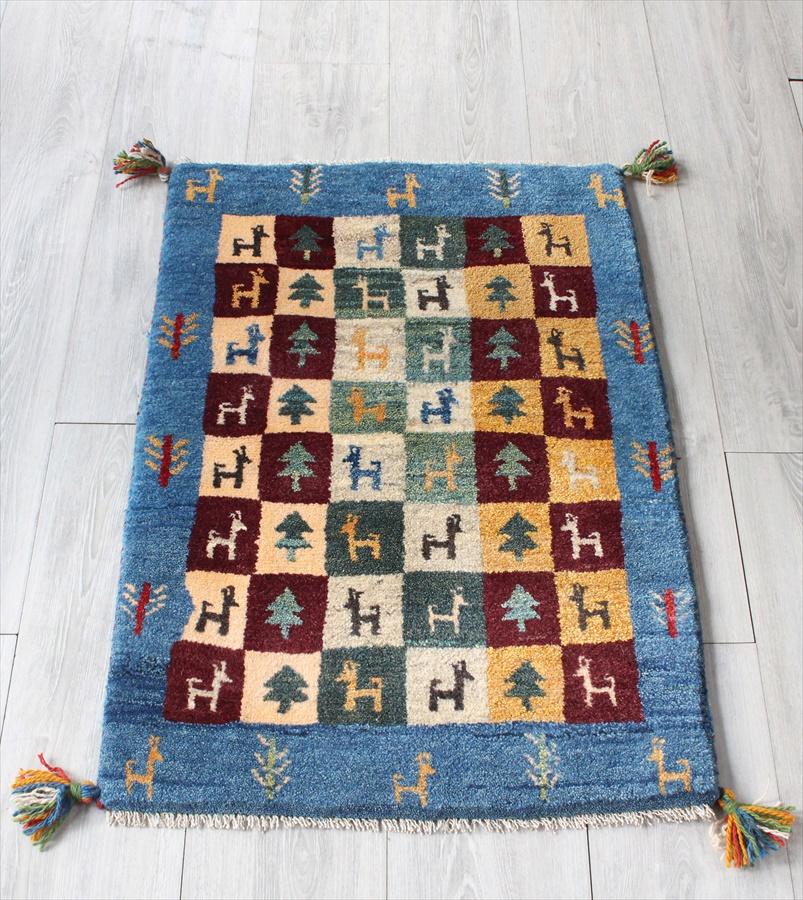 ギャッベ/Gabbeh イラン製 手織りラグ・玄関マットサイズ84x59cm ブルー カラフルなタイル 動物と植物のモチーフ