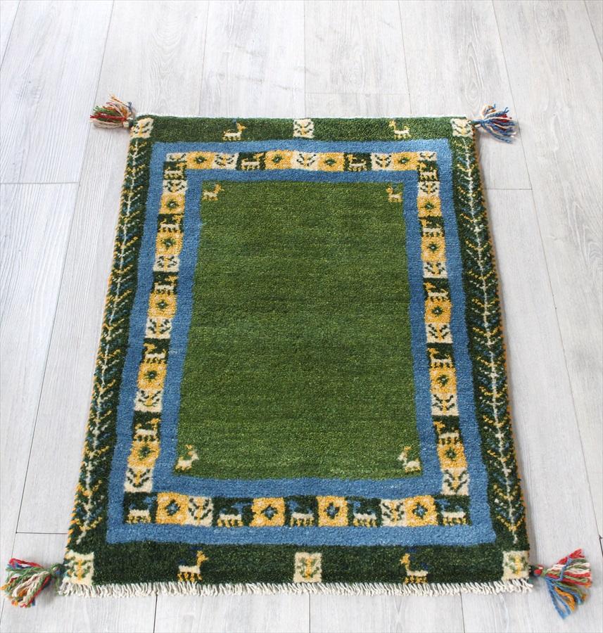 ラグ・ギャッベ(ギャベ)カシュカイ族の手織りラグ・玄関マットサイズ85x58cm グリーン カラフルなタイルの縁どり
