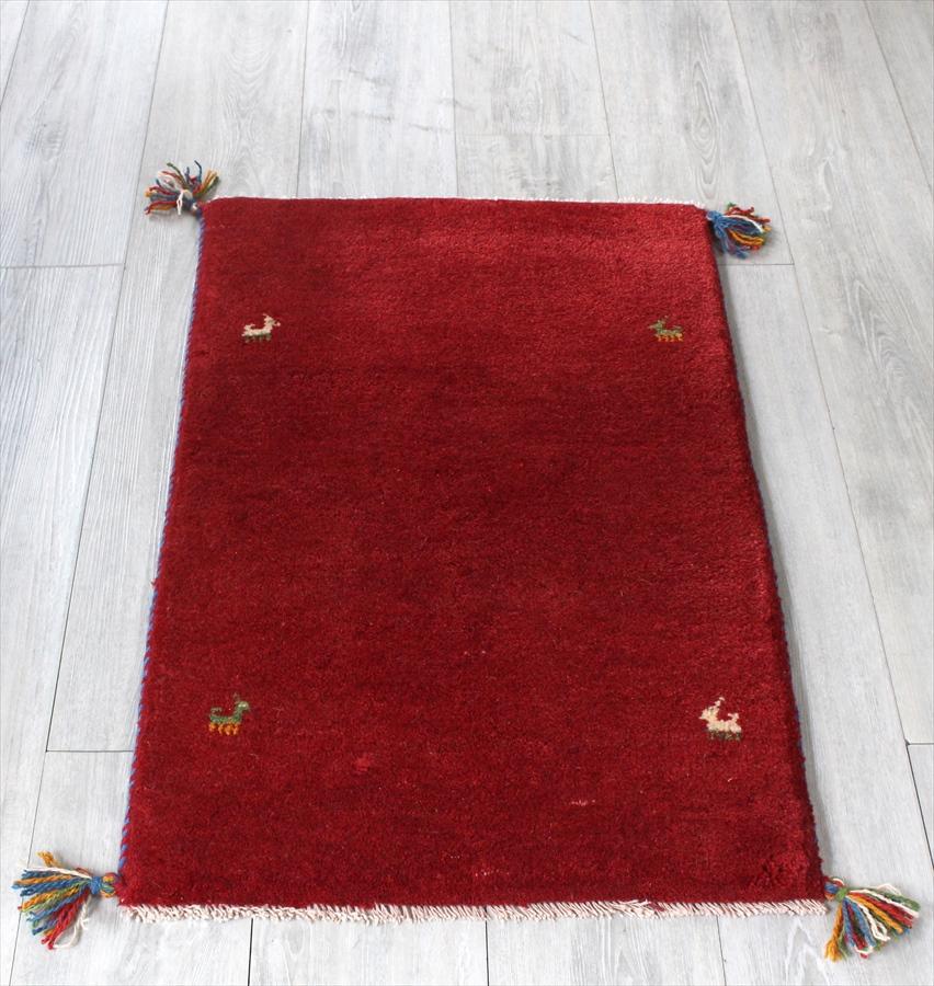 ラグ・ギャッベ(ギャベ)カシュカイ族の手織りラグ・玄関マットサイズ89x57cm レッド 小さな動物のモチーフ