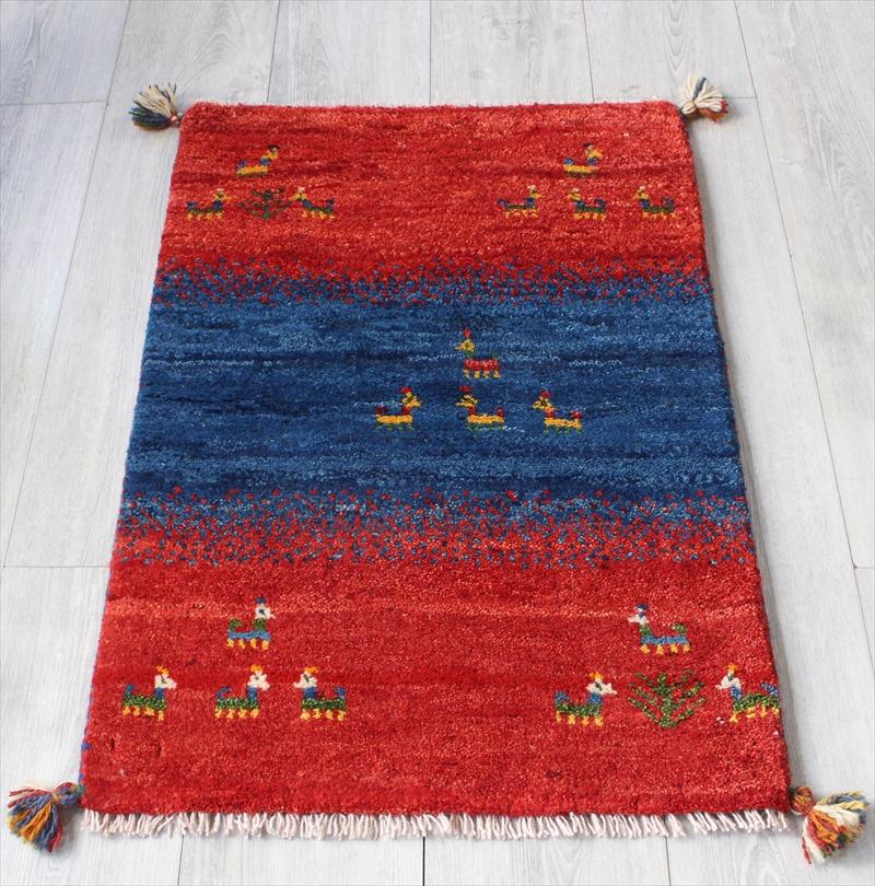 ラグ・ギャッベ(ギャベ)カシュカイ族の手織りラグ・玄関マットサイズ83x56cm レッド&ブルー 動物モチーフ