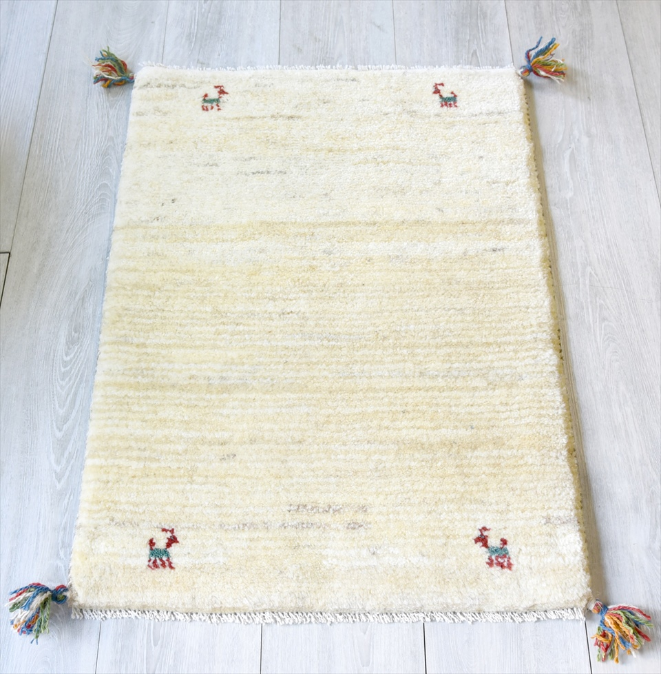 ギャッベ/GABBEH ベーシックな織り カシュカイ族の手織り・玄関マットサイズ85×61cmアイボリー 動物のモチーフ